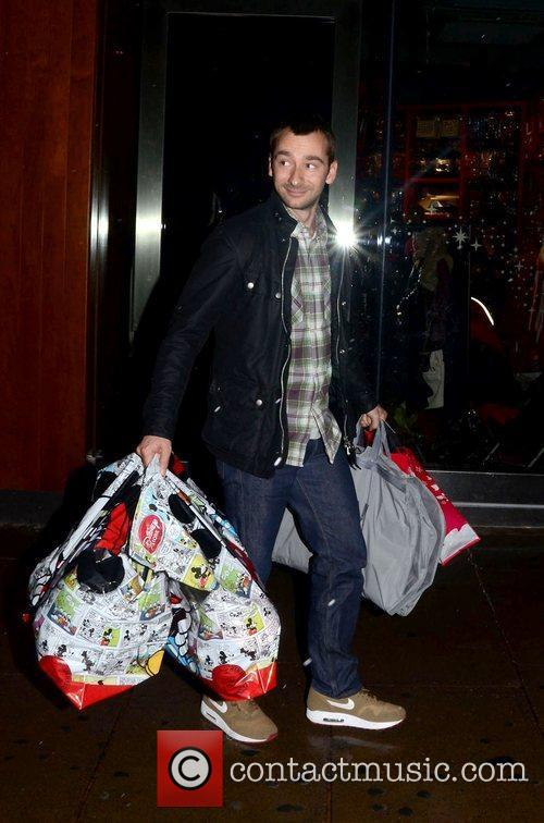 Charlie Condou leaving the Disney store on Oxford...