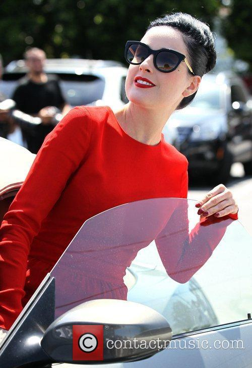 Dita Von Teese returning to her car after...