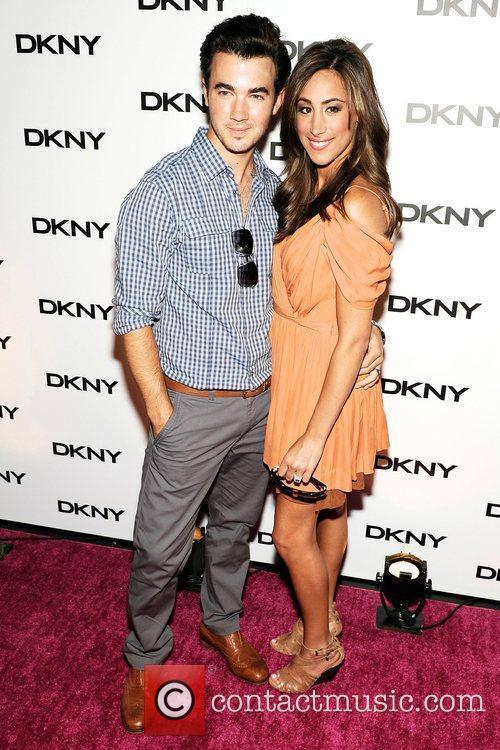 Kevin Jonas and Danielle Deleasa attends DKNY Sun...