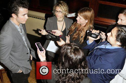 Kevin Jonas being interviewed at the 2011 Do...