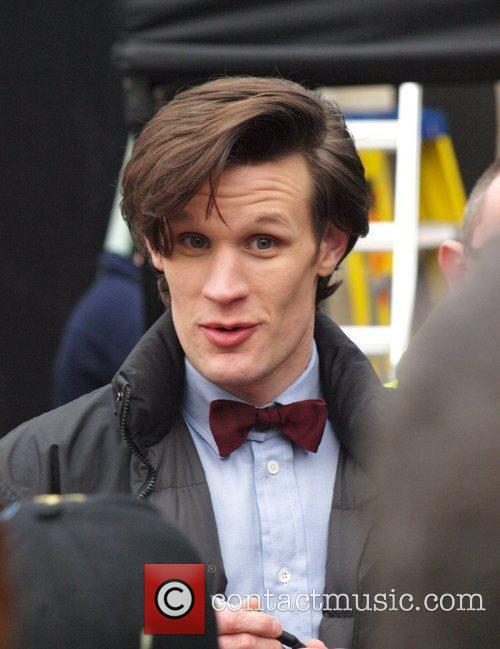 Matt Smith signs autographs for fans as he...