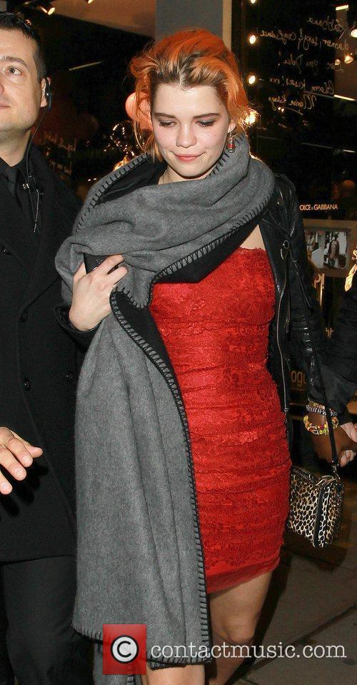 Pixie Geldof covers up her red dress in...