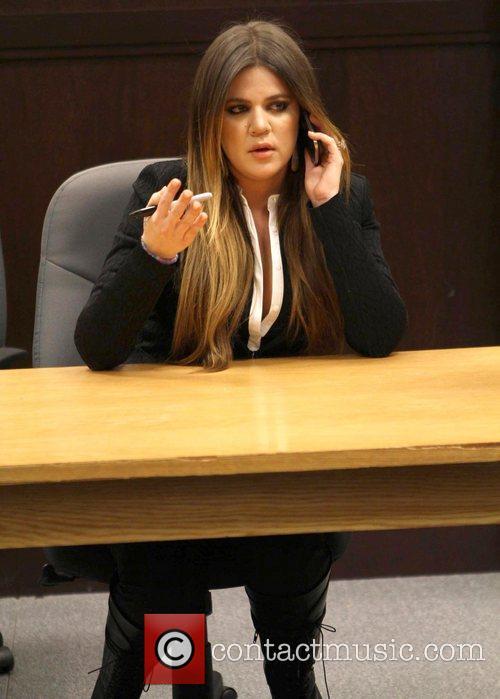Khloe Kardashian and Kourtney Kardashian sign copies of...