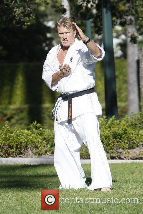 Dolph Lundgren practicing martial arts at a park...
