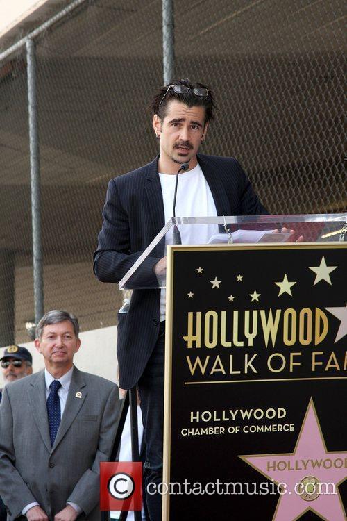 Colin Farrell makes a speech as Donald Sutherland...