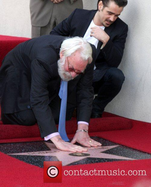 Donald Sutherland with Colin Farrell as he receives...