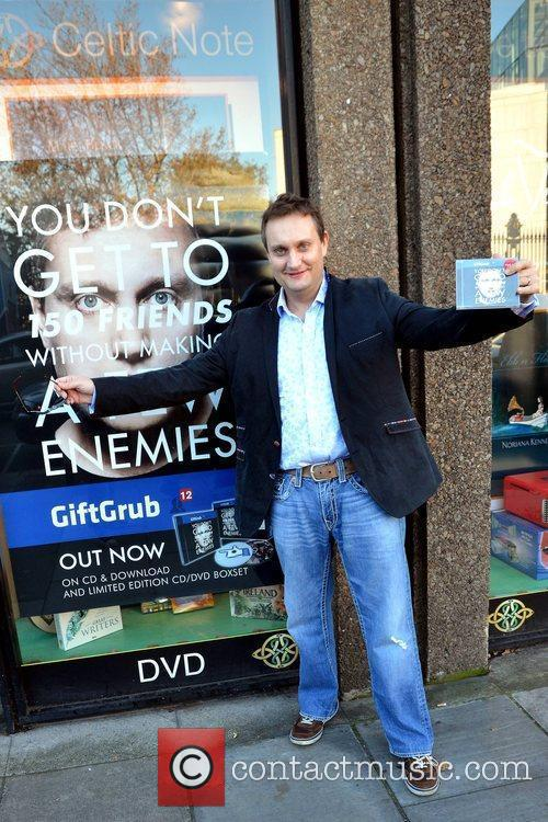 Comedian Mario Rosenstock signs 'Gift Grub 12' at...