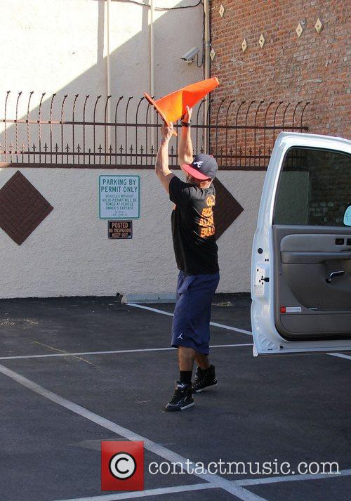 J.R. Martinez throws a traffic cone after it...