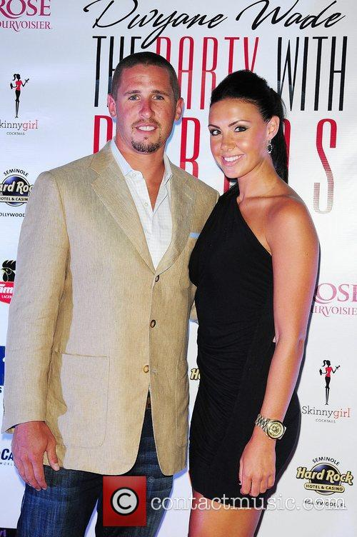 Miami Dolphins player Brian Hartline and guest a...
