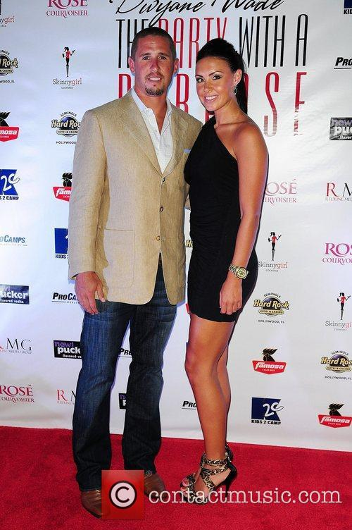 Miami Dolphins player Brian Hartline and guest Dwyane...