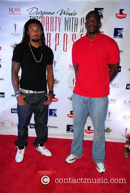 Miami Dolphins player Nolan Carroll and Derek Drummad...