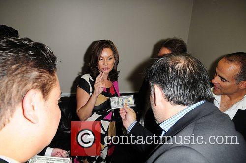 United State Treasurer Rosie Rios (C) showing the...