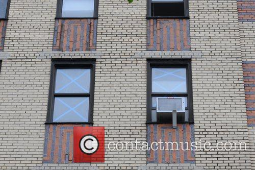 Buildings have their windows taped in Queens in...