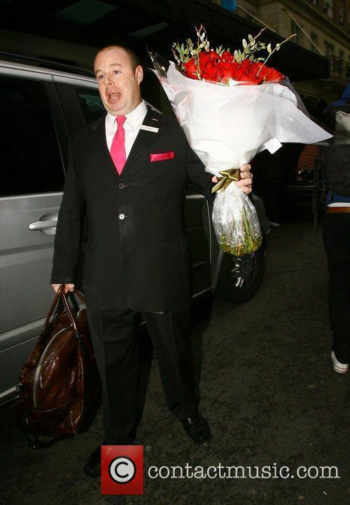 Elen Rivas's driver carrying some roses