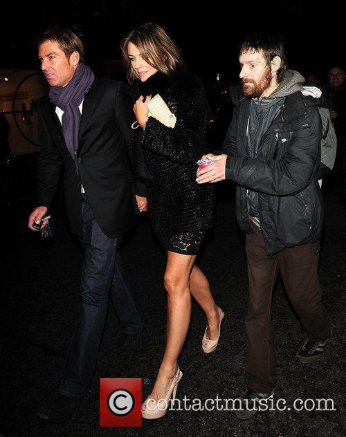 Elizabeth Hurley and Shane Warne leaving C London...