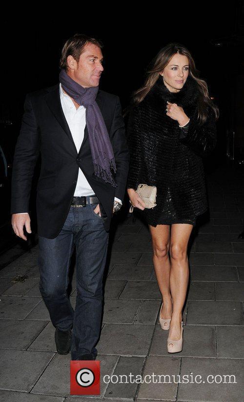 Shane Warne and Elizabeth Hurley ,  leaving...