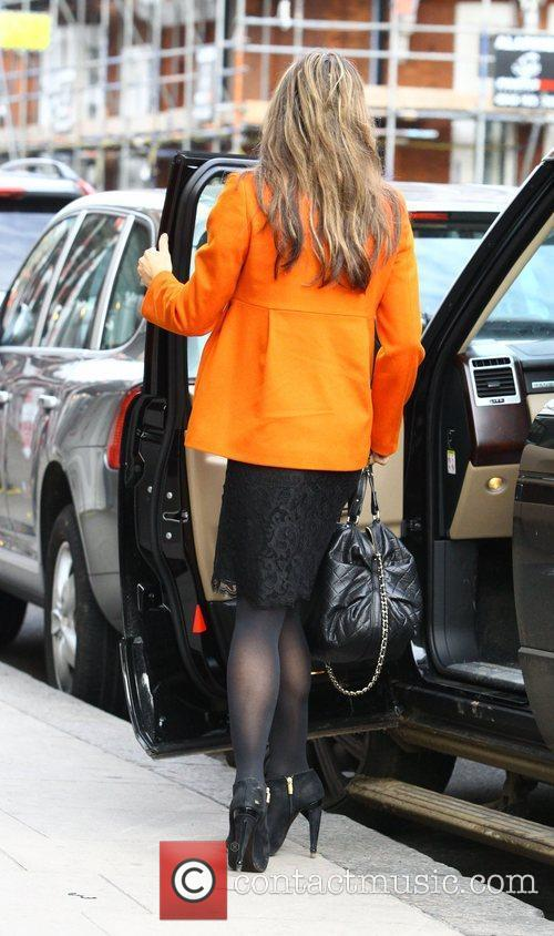 Elizabeth Hurley  gets out of the car...