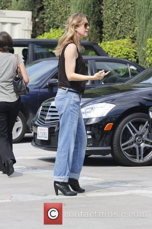 Wears baggy jeans outside Urth Caffe in Studio...