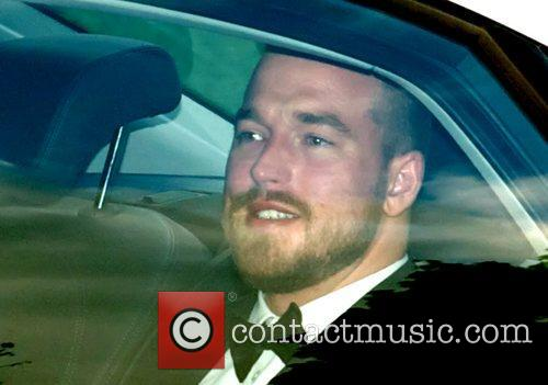 Andrew Cowles arriving by car to Elton John's...