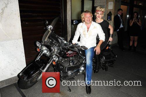 Katie Waissel and Mark Fuller on a Harley...