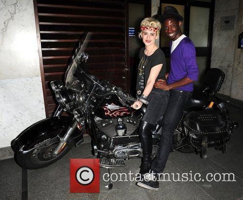 Katie Waissel and John Adeleye on a Harley...