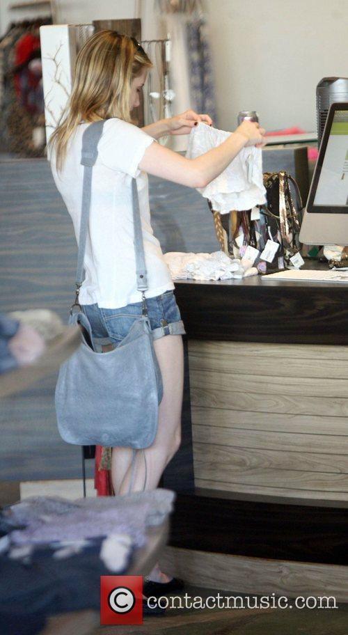 Emma Roberts shops for underwear at Planet Blue...
