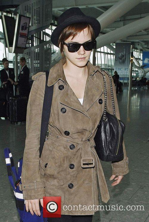 Wearing a hat and sunglasses as she arrives...