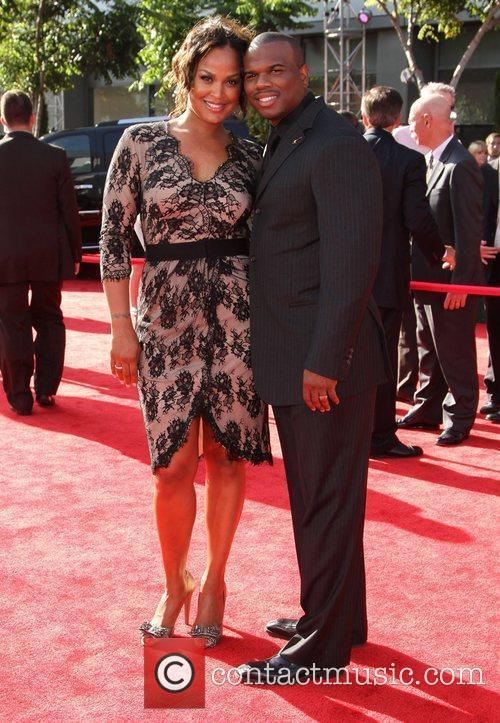 Laila Ali and her husband, former NFL player...