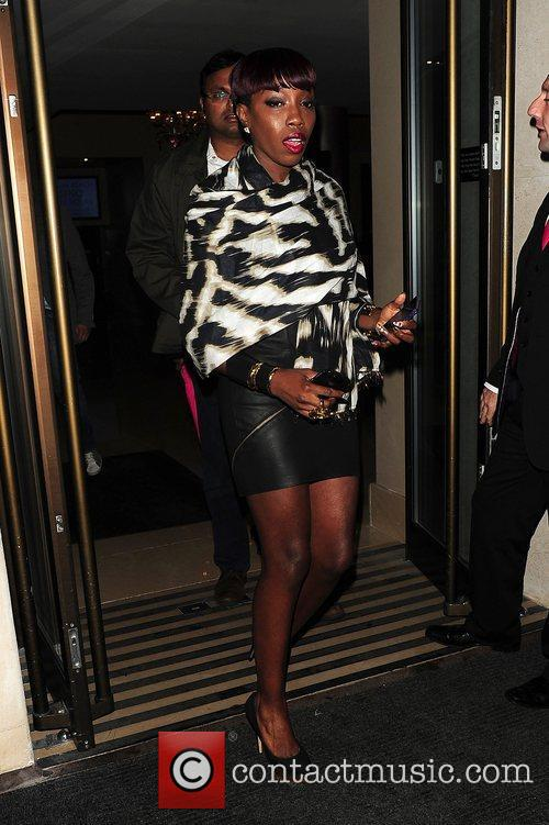 Singer Estelle out and about wearing a zebra...