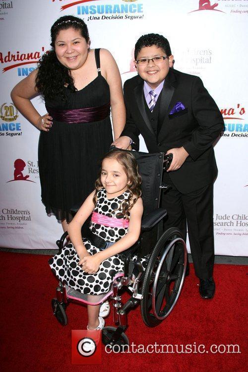 Raini Rodriguez and Rico Rodriguez with Elizabeth Lobapo...