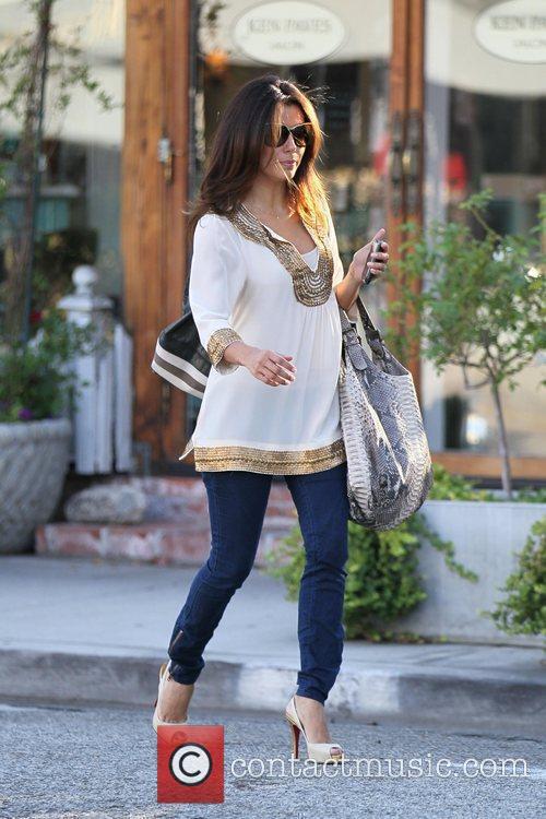 Eva Longoria exits the Ken Paves salon after...