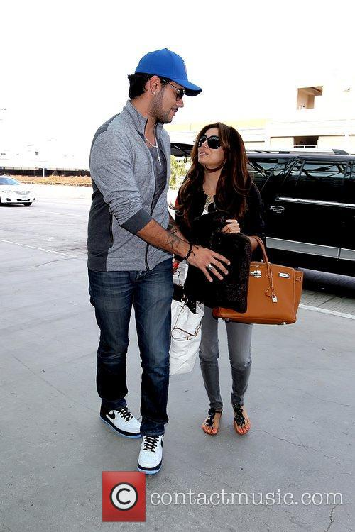 1Eduardo Cruz and Eva Longoria arrive at LAX...