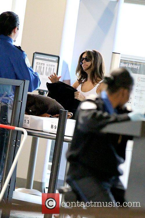 Eva Longoria waiting in line at LAX to...