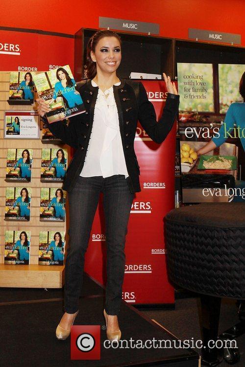 Eva Longoria  signs her copies of her...