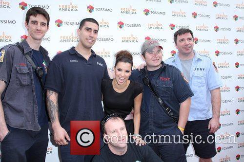 Eva Longoria posing with members of FDNY Grand...