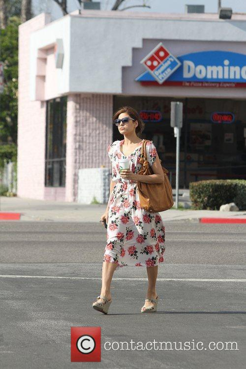 Eva Mendes in a summer rose patterned dress,...