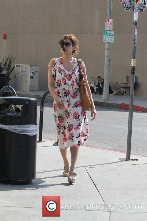 Eva Mendes in a summer rose patterned dress,...
