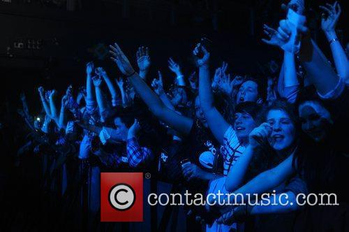 Fans of Example performing at the O2 Arena...