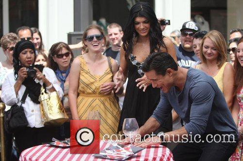 Teresa Giudice and Mario Lopez filming for the...