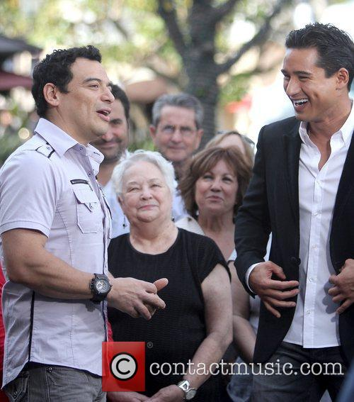 Carlos Mencia and Mario Lopez Celebrities filming an...