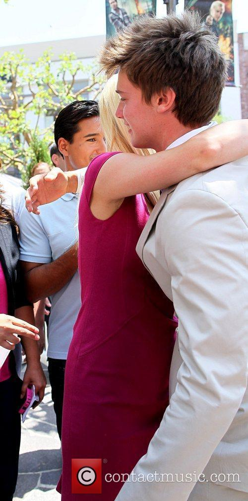 Paris Hilton bumps into Patrick Schwarzenegger and gives...