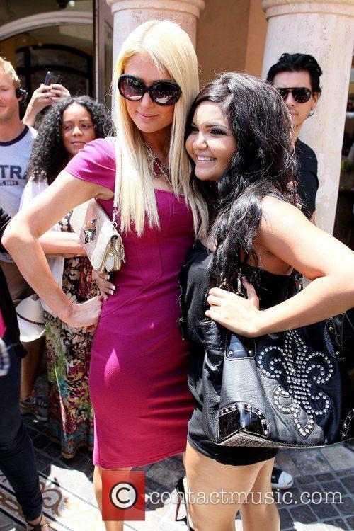 Paris Hilton poses with a fan Paris Hilton...