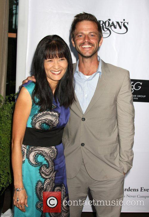Suzanne Whang and Carmine Giovinazzo