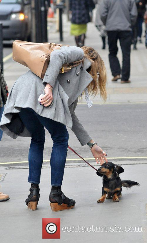 Fearne Cotton strokes a little dog outside the...