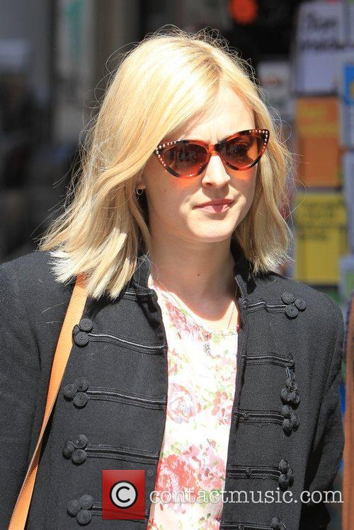 Shows off her new shorter hair as she...