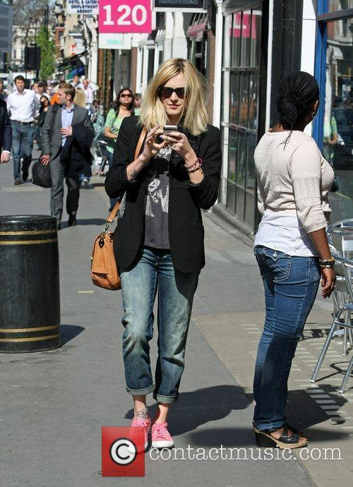 Fearne Cotton talking on her mobile phone as...