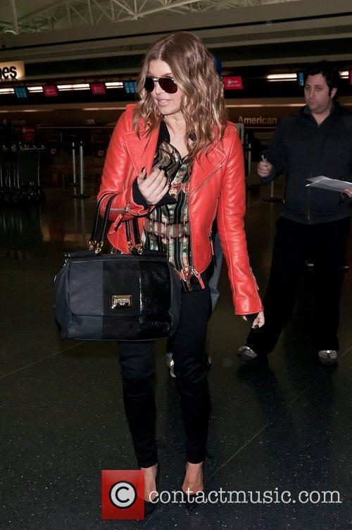 Fergie of the Black Eyed Peas leaves JFK...