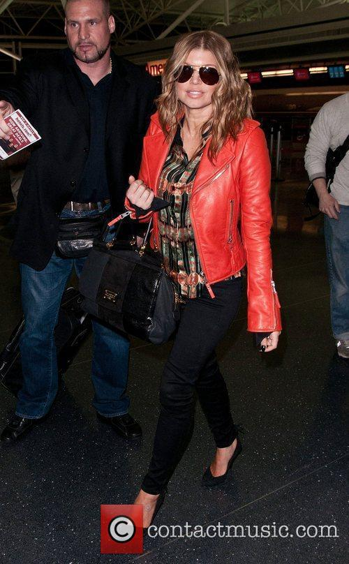 Fergie of the Black Eyed Peas leaves JFK...
