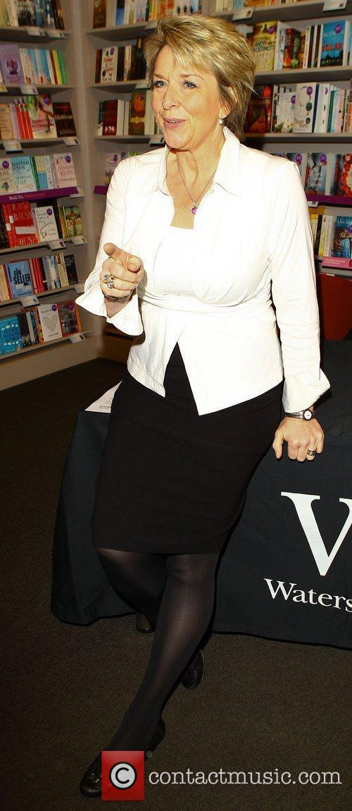 Attends a book signing for her book debut...