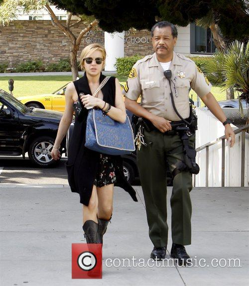 *file Photo* * LOHAN GETS PROBATION FOR THEFT...